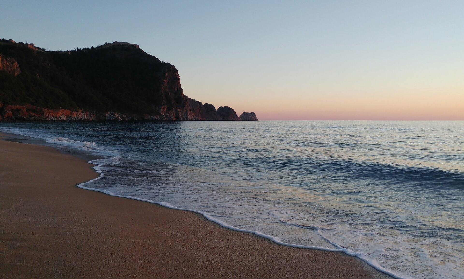 Strand bei sonnenuntergang Antalya Tuerkei